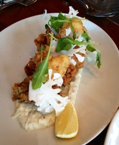 Deliciously fried oysters atop a smather of housemade cauliflower tartar sauce.