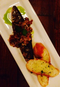Fresh, grilled sardine with an olive caper tapenade and tarragon oil drizzle.