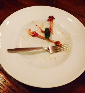 A deliciously empty plate that once held a savory Confit Duck & Cassoulet with house-cured pork belly and maple candied carrot.